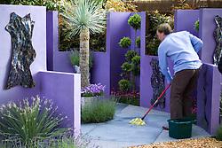Final preparations in the Reflections Garden, Chelsea Flower Show 2005. Designer: David Domoney