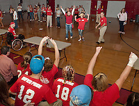 """At the LHS Pep Rally for Homecoming Sophomores make a good attempt in the """"minute to win it"""" games.   (Karen Bobotas/for the Laconia Daily Sun)"""