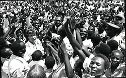 Feb. 02, 1975 - President Idi Amin of Uganda with Canadian TV Personality Martin Burke surrounded by friendly crowd in Kaugala. Credit: Camerapix (Credit Image: © Keystone Press Agency/Keystone USA via ZUMAPRESS.com)