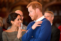 Prince Harry and Meghan Markle watch a dance performance by Jukebox Collective in the banqueting hall during a visit to Cardiff Castle.