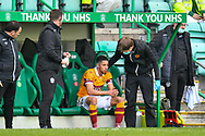 Jake Carroll (#3) of Motherwell FC sit-ins on the bench after leaving the field after a clash of heads during the SPFL Premiership match between Hibernian FC and Motherwell FC at Easter Road, Edinburgh, Scotland on 27 February 2021.
