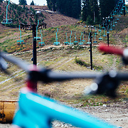 Mountain Bikes and chairlifts match colors at Steven's Pass Resort.