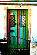 An old, colorful doorway on the outskirts of Tavira, Portugal