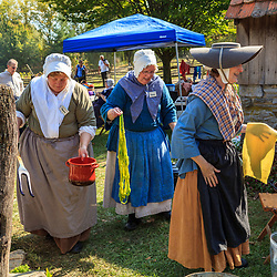 Lancaster, PA - October 14, 2012: Interpreters dressed in period clothing demonstrate dyeing yarn at the Landis Valley Village & Farm Museum in Lancaster County, Pennsylvania.