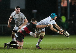Ospreys' Justin Tipuric is tackled by Dragons' James Benjamin<br /> <br /> Photographer Simon King/Replay Images<br /> <br /> Guinness Pro14 Round 12 - Dragons v Cardiff Blues - Sunday 31st December 2017 - Rodney Parade - Newport<br /> <br /> World Copyright © 2017 Replay Images. All rights reserved. info@replayimages.co.uk - http://replayimages.co.uk