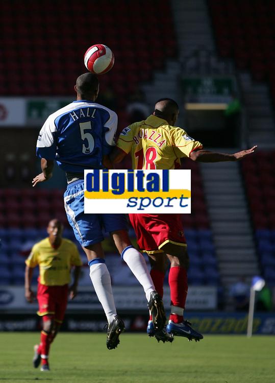 Photo: Andi Thompson.<br />Wigan Athletic v Watford. The Barclays Premiership. 23/09/2006.<br />Wigan's Fitz Hall (L) beats Watford's Hamer Bouazza (R) to the ball