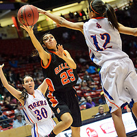 031314  Adron Gardner/Independent<br /> <br /> Gallup Bengal Rebecca Herrera (25) attempts a field goal  ahead of  Los Lunas Tiger  Jordan Holland (12) during the state high school basketball tournament at The Pit in Albuquerque Thursday.