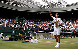 Roger Federer with the trophy after beating Marin Cilic in the Gentlemen's Singles Final on day thirteen of the Wimbledon Championships at The All England Lawn Tennis and Croquet Club, Wimbledon.