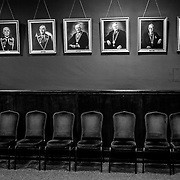 Former presidents of the Apprentice Boys of Derry line the wall in the organizations meeting chamber. Northern Ireland, September 2019