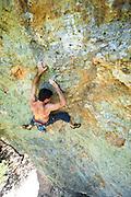 "Jonathan Lowell climbing ""Ceiling Zero"" (5.12a), Mt. St. Helena, in Robert Louis Stevensen State Park, Napa Valley, California"
