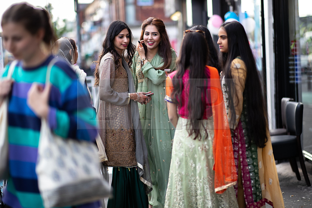© Licensed to London News Pictures. 15/06/2018. Manchester, UK. People celebrate Eid-ul-Fitr , the end of a month of fasting during Ramadan , in Rusholme in Manchester . Photo credit: Joel Goodman/LNP