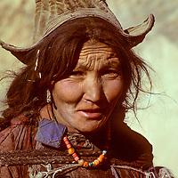 INDIA, Ladakh, (Kashmir). Ladakhi woman with traditional hat & jewelry.  Kanji village, Zanskar Mts.