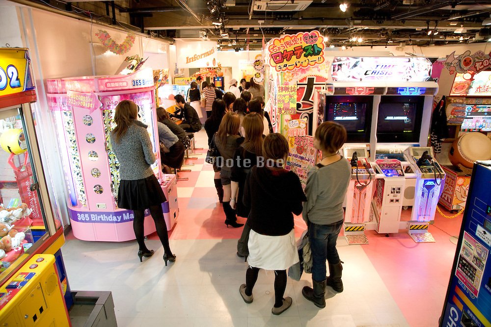 young adult girls at a game store in Tokyo Japan
