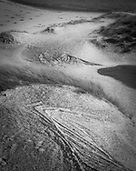 Rippled sand dunes dusted with a sprinkling of snow at Achnahaird beach in Assynt, Scotland.