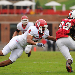 Sep 26, 2009; College Park, MD, USA; Maryland wide receiver Torrey Smith (82) runs through an attempted tackle by Rutgers cornerback David Rowe (4) during the first half of Rutgers' 34-13 victory over Maryland in NCAA college football at Byrd Stadium.