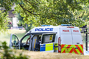 A police van is seen parked up at a crime scene nearby Westbourne Park Open Space in Bourne Terrace on Sunday, Sept 20, 2020 - after a woman has been found suffering from knife wounds and pronounced dead in West London, which police say it is believed to be self-inflicted. (VXP Photo/ Vudi Xhymshiti)