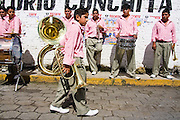 A brass band waits for the parade to begin in Paracho, Michoacan state, Mexico on August 7, 2008 during the annual Feria Internacional de la Guitarra.