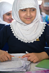 Pupil in a lesson at the Nottingham Islamia school,