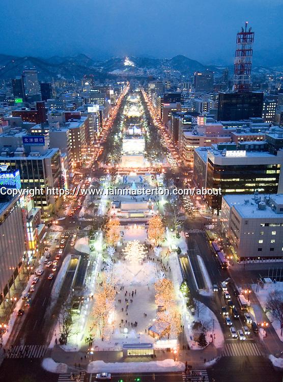 Evening view of illuminated Odori Park during winter snow festival in Sapporo Japan