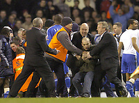 Photo: Olly Greenwood.<br />Tottenham Hotspur v Chelsea. The FA Cup, Quarter Final replay. 19/03/2007. A Spurs fan runs onto the pitch and is broght under control byh security guards