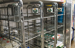 © Licensed to London News Pictures. 31/07/2021. London, UK. Nearly-empty shelves of milk in Sainsbury's, north London. The UK's biggest milk processor, Arla Foods UK, has said that about 600 individual stores out of the 2,400 that it routinely supplies missed a delivery due to the pingdemic and a lack of lorry drivers. The pingdemic has seen staff shortages at supermarkets, resulting in less stock making its way to supermarket shelves. Photo credit: Dinendra Haria/LNP