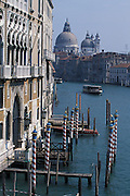 View of the Grand Canal and The Basilica di Santa Maria della Salute (Basilica of St Mary of Health/Salvation), commonly known simply as the Salute, is a famous church in Venice, Italy. Placed scenically at a narrow finger of land which lies between the Grand Canal and the Bacino di San Marco on the lagoon, visible as one enters the Piazza San Marco from the water. While it has the status of a minor basilica, its decorative and distinctive profile and location make it among the most photographed churches in Italy...Subject photograph(s) are copyright Edward McCain. All rights are reserved except those specifically granted by Edward McCain in writing prior to publication...McCain Photography.211 S 4th Avenue.Tucson, AZ 85701-2103.(520) 623-1998.mobile: (520) 990-0999.fax: (520) 623-1190.http://www.mccainphoto.com.edward@mccainphoto.com.