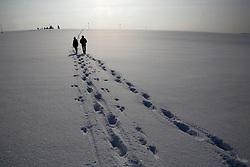 CZECH REPUBLIC VYSOCINA NEDVEZI 27JAN12 - Two hikers leave a path in the snowy winter landscape near the village Nedvezi, Vysocina, Czech Republic.....jre/Photo by Jiri Rezac....© Jiri Rezac 2012