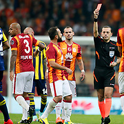 Referee's Cuneyt Cakir show the red card to Fenerbahce's Bruno Eduardo Regufe Alves during their Turkish superleague soccer derby match Galatasaray between Fenerbahce at the AliSamiYen spor kompleksi TT Arena in Istanbul Turkey on Saturday, 18 october 2014. Photo by Aykut AKICI/TURKPIX