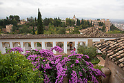 The Alhambra Palace and fortress complex located in Granada, Andalucia, Spain.  View over the gardens from Genaralife area towards the Church of Santa Maria de la Alhambra.