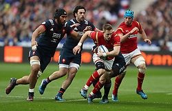 Wales Liam Williams is tackled by France's Noa Nakaitaci during the RBS 6 Nations match at the Stade de France, Paris.