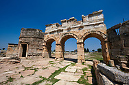 Picture of the Roman North Gate built by Domitian. Hierapolis archaeological site near Pamukkale in Turkey. .<br /> <br /> If you prefer to buy from our ALAMY PHOTO LIBRARY  Collection visit : https://www.alamy.com/portfolio/paul-williams-funkystock/pamukkale-hierapolis-turkey.html<br /> <br /> Visit our TURKEY PHOTO COLLECTIONS for more photos to download or buy as wall art prints https://funkystock.photoshelter.com/gallery-collection/3f-Pictures-of-Turkey-Turkey-Photos-Images-Fotos/C0000U.hJWkZxAbg .<br /> <br /> If you prefer to buy from our ALAMY PHOTO LIBRARY  Collection visit : https://www.alamy.com/portfolio/paul-williams-funkystock/pamukkale-hierapolis-turkey.html<br /> <br /> Visit our TURKEY PHOTO COLLECTIONS for more photos to download or buy as wall art prints https://funkystock.photoshelter.com/gallery-collection/3f-Pictures-of-Turkey-Turkey-Photos-Images-Fotos/C0000U.hJWkZxAbg