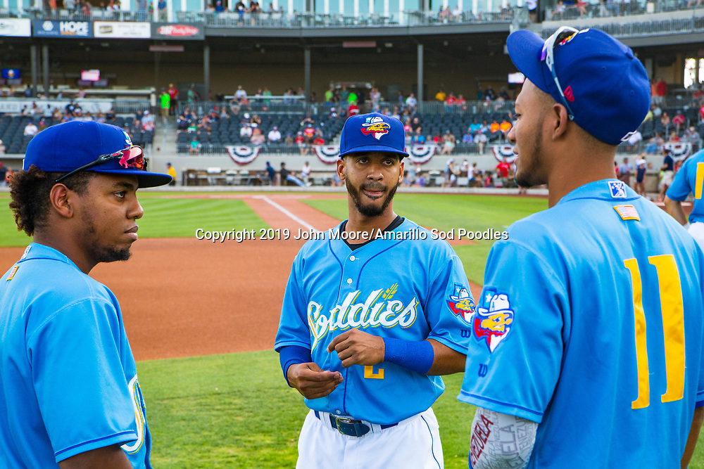 Amarillo Sod Poodles outfielder Rodrigo Orozco (1), infielder Ivan Castillo (2), and outfielder Edward Olivares (11) before the game against the Northwest Arkansas Travelers on Sunday, July 21, 2019, at HODGETOWN in Amarillo, Texas. [Photo by John Moore/Amarillo Sod Poodles]