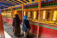 Tibetan pilgrims circumambulates around the Tandruk Monastery, Tibet (Xizang), China