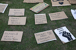 Signs containing names of people who died as a result of racial or police violence are laid out on the grass during a peaceful protest in solidarity with the Black Lives Matter movement on 13th June 2020 in Salt Hill Park in Slough, United Kingdom. Protests in solidarity with the Black Lives Matter movement have taken place across the United States and in many countries around the world.