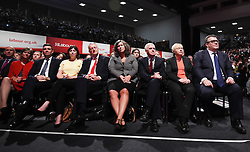 © Licensed to London News Pictures. 29/09/2015. Brighton, UK. Members of the shadow cabinet L TO R ANDY BURNHAM (third left), LUCY POWELL, HILARY BENN, HIEDI ALEXANDER, JOHN MCDONNELL, ANDREA EAGLE and TOM WATSON listen to Labour party leader JEREMY CORBYN  deliver his leader speech on day three of the 2015 Labour Party Conference, held at the Brighton Centre in Brighton, East Sussex.  Photo credit: Ben Cawthra/LNP