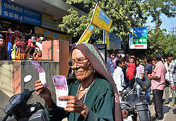 November 12, 2016 - Jaipur, Rajasthan, India - An old woman show new currency Rs 2000 notes  after exchange discontinued Rs 500,1000 currency notes outside a bank in Jaipur, India, Saturday, Nov. 12, 2016. Long queues have grown longer, scuffles have broken out and chaotic scenes are being seen across India as millions of people waited to change old currency notes that have become worthless after the government's demonetized high value bills. (Photo By Vishal Bhatnagar/NurPhoto) (Credit Image: © Vishal Bhatnagar/NurPhoto via ZUMA Press)