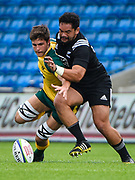 New Zealand hooker Leni Apisai competes for a loose ball with Australia flanker Liam Wright during the World Rugby U20 Championship 5rd Place play-off  match Australia U20 -V- New Zealand U20 at The AJ Bell Stadium, Salford, Greater Manchester, England on Saturday, June  25  2016. (Steve Flynn/Image of Sport)