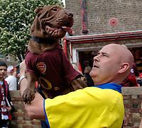 Photo: Daniel Hambury.<br />Arsenal v Wigan Athletic. The Barclays Premiership. 07/05/2006.<br />Arsenal fan Tim Loftus with his dog brusier, both ewearing Arsenal shirts.