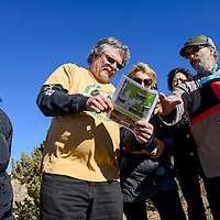 112214       Cable Hoover<br /> <br /> Chris Shuey, center, and Paul Robinson from the Southwest Research and Information Center show a map to visitors from Russia and Mongolia during a tour of UNC section 17 in Churchrock Saturday.