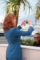 Lea Seydoux taking a selfie  at the photo call for the film Saint Laurent at the 67th Cannes Film Festival, Saturday 17th May 2014, Cannes, France.