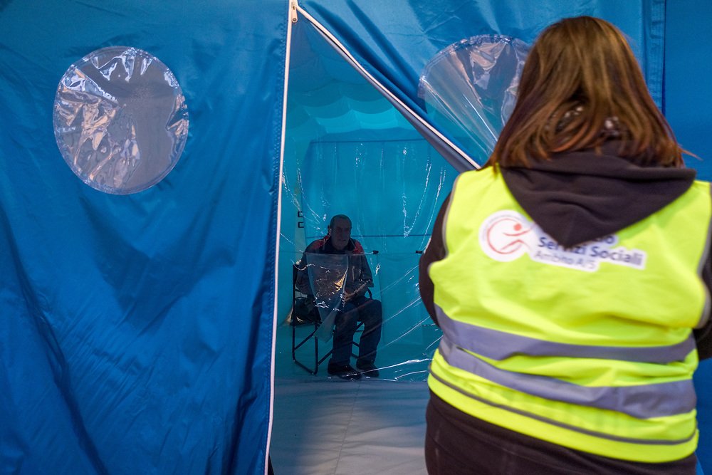 An elder sits in a 'hug room', a special room where people can meet their relatives through a plastic sheet to keep people safe from COVID-19 infection at a care home in Santa Lucia di Serino, province of Avellino, southern Italy, on January 2, 2021.