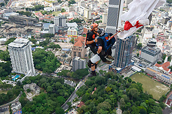 Oct. 3, 2016, Kuala Lumpur, Malaysia - Base jumpers leap from the 300-metre high open deck at Kuala Lumpur Tower on the final day of the International Tower Base Jump competition. More than 121 professional base jumpers from 20 countries took part in the event. (Credit Image: © Chris Jung via ZUMA Wire)