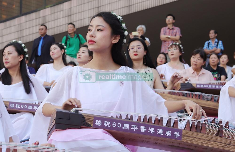 October 4, 2018 - Hong Kong, CHINA - Young women perform traditional music piece on a Chinese classical harps outdoor as part of continued China national day celebration in Hong Kong.Oct-4,2018 Hong Kong.ZUMA/Liau Chung-ren (Credit Image: © Liau Chung-ren/ZUMA Wire)