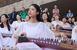October 4, 2018 - Hong Kong, CHINA - Young women perform traditional music piece on a Chinese classical harps outdoor as part of continued China national day celebration in Hong Kong.Oct-4,2018 Hong Kong.ZUMA/Liau Chung-ren (Credit Image: © Liau Chung-ren/ZUMA Wire)