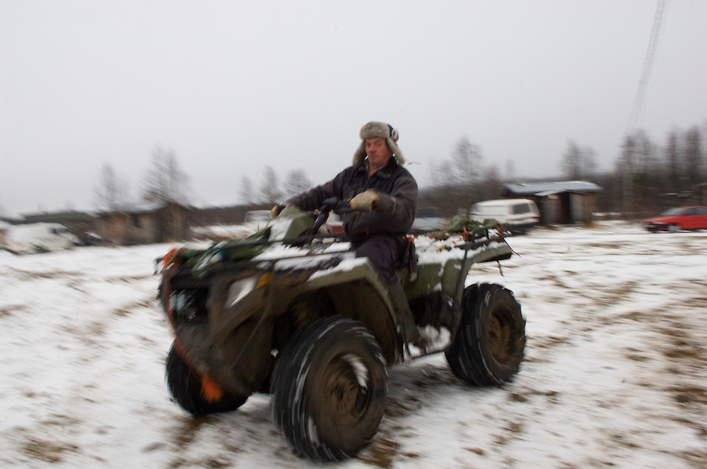 Charging past on his 4x4 ATV, Vegai heads to tend to the reindeer herds.  The introduction of four wheelers about 15 years ago has been both a boon and bane- easing the process of herding but adding significantly to costs.  Despite the inhospitable Arctic climate reindeer herding has been the livelihood of the Sami for more than a thousand years, but amid the economic, technological, and environmental problems of modern society their indigenous culture must increasingly reconcile these radical changes in order to preserve age-old traditions, customs, and mores...