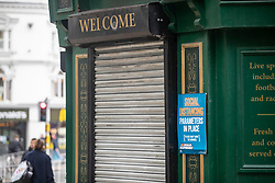 © Licensed to London News Pictures. 13/10/2020. Liverpool, UK. A shuttered pub entrance in Liverpool, which is due to enter Tier 3 lockdown on Wednesday. The lockdown will see the closure of pubs, bars, bookmakers, gyms and casinos as well as a ban on overnight stays outside of the home. Photo credit: Kerry Elsworth/LNP