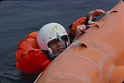 "The first female NASA astronauts qualify in Water Survival School at Turkey Point, Florida. NASA Astronaut candidate Anna L. Fisher as a boat pulls her through the water during an Air Training Command sea survival school ""Drop-and-Drag"" Exercise. The boat will pull her until she can stabilize herself and release the parachute risers. The exercise is designed to simulate being dragged through the water by a parachute. Fisher's classmates include Sally K. Ride, Shannon W. Lucid, Kathryn D. Sullivan, Margaret ""Rhea"" Seddon and Judith A. Resnik."