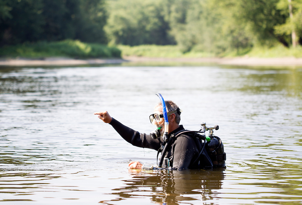 Byron Karns, an aquatic biologist with the National Park Service, prepares to dive and collect mussels for observation in the Mississippi River near Pike Island August 14, 2015. Endangered mussel species have been reintroduced in the area, and Karns is working with multiple agencies to assess the health of all mussels in the river.