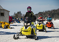 A group of snowmobilers heading into Alton Bay on Lake Winnipesaukee for Winter Carnival Sunday afternoon.  (Karen Bobotas/for the Laconia Daily Sun)