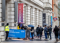 © Licensed to London News Pictures. 18/03/2021. London, UK. Members of the public queue up at a vaccine centre at the Science Museum in South Kensington, West London as Health Secretary Matt Hancock says there will be no cancelled appointments despite 1.7 million doses of the Oxford-AstraZeneca vaccine being delayed by up to a month. Photo credit: Alex Lentati/LNP